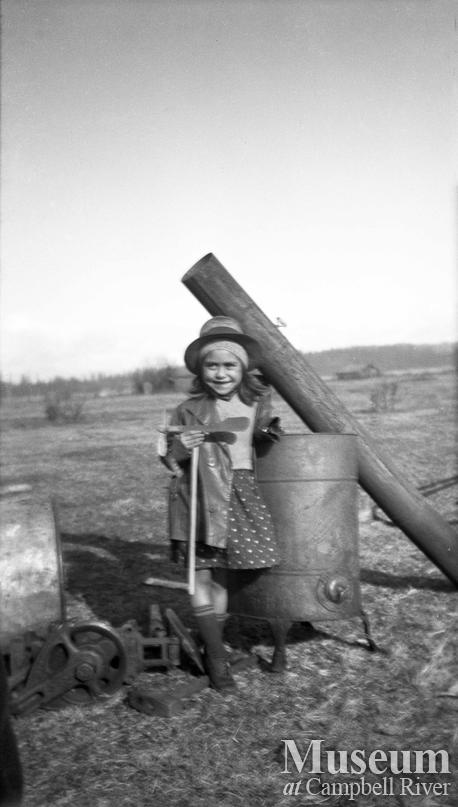 An unidentified young girl with a whirligig toy