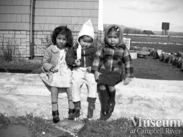Three young children - Maggie Henderson on left