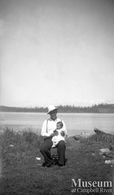 Sam Henderson and child