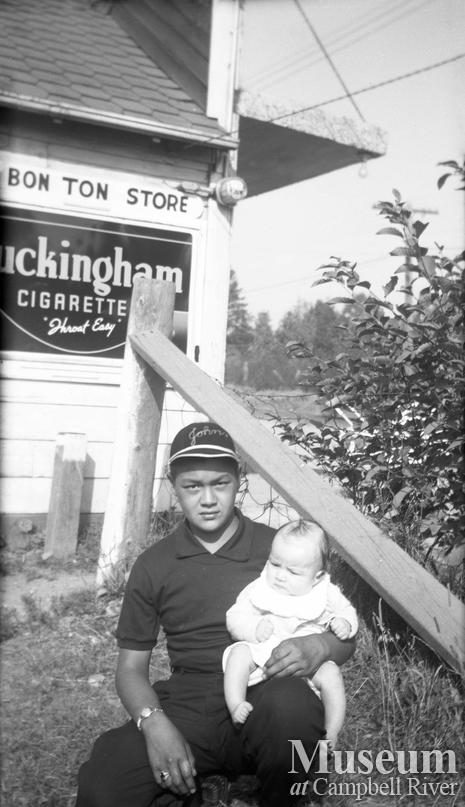 Johnny Ferry Jr. in front of the Bon Ton Store