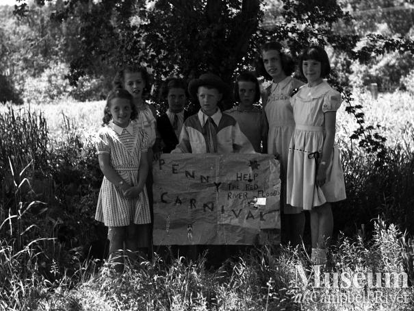 A group of children advertising a Penny Carnival