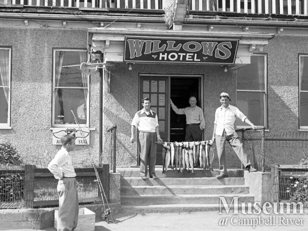 Anglers with their catch on front steps of the Willows Hotel.