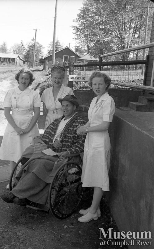 Nurses with patient outside Lourdes Hospital, Campbell River