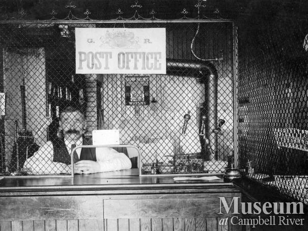 Mr. Hardy, Assistant Postmaster, inside the Post Office