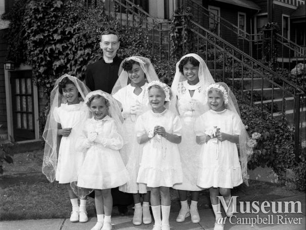Priest with group of girls being confirmed