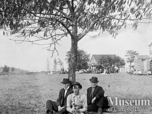 Group of loggers behind the first Willows Hotel