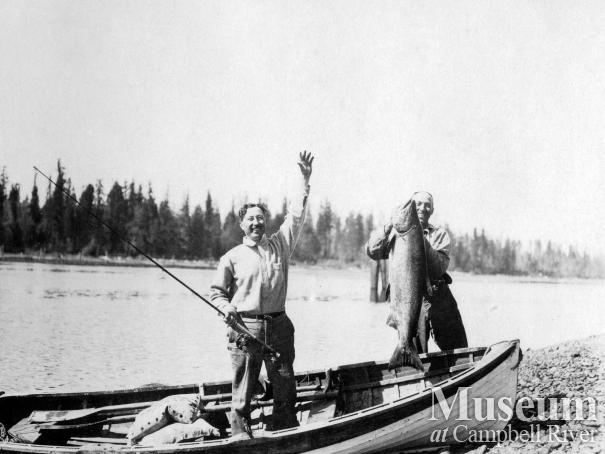 Dr. Wiborn and Herbert Pidcock fishing