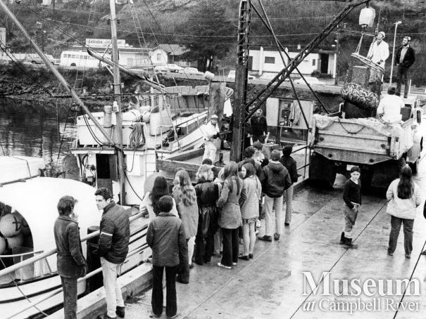Fishing boat unloading at Campbell River wharf