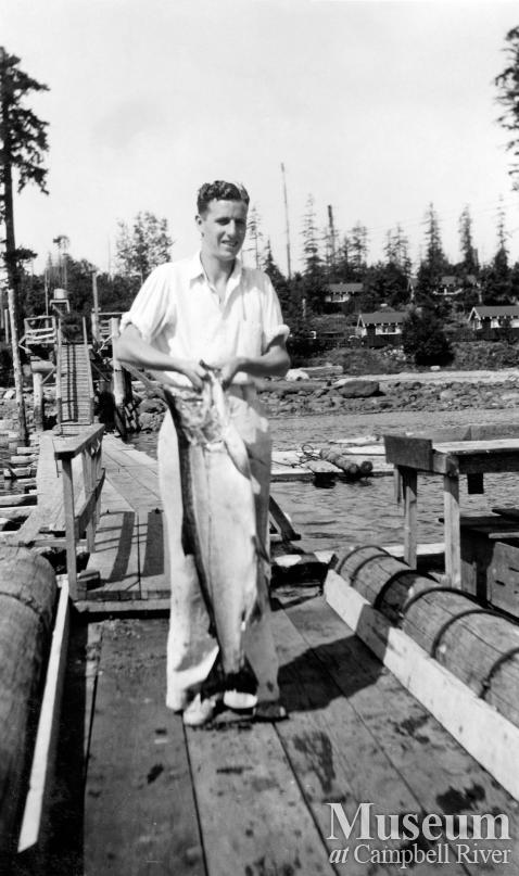 B. Smith with a fish on the Painter's Lodge wharf