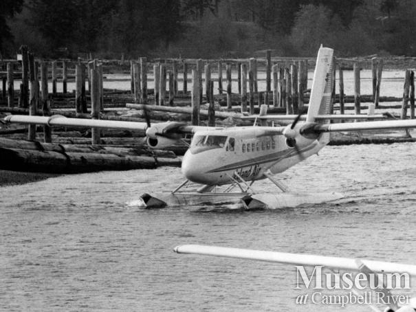 An Island Air seaplane in front of the ERT log dump