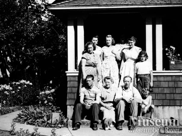Group on the front steps of the Petersen family home, Campbellton