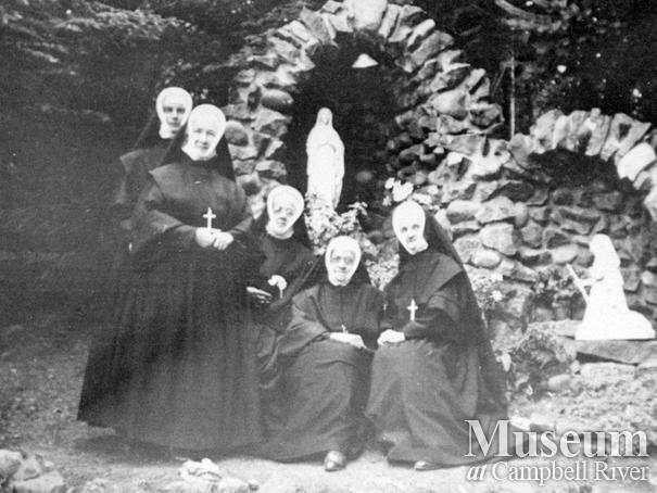 Group of the Sisters beside the Grotto at the Lourdes Hospital