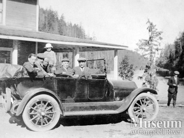 Car with passengers beside Forbes Landing Lodge