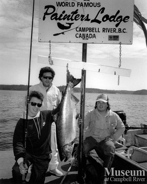 Three unknown anglers with fish
