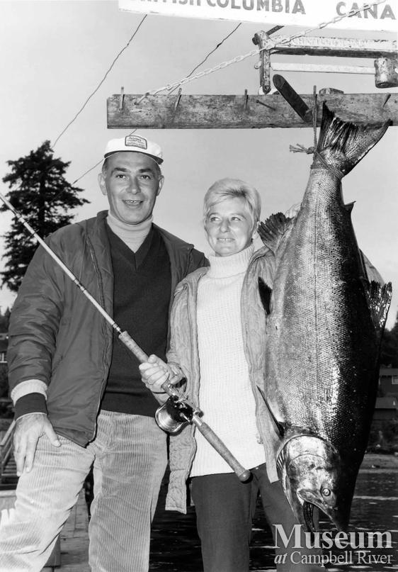 Mrs. Irvin Janko with her catch, and a man
