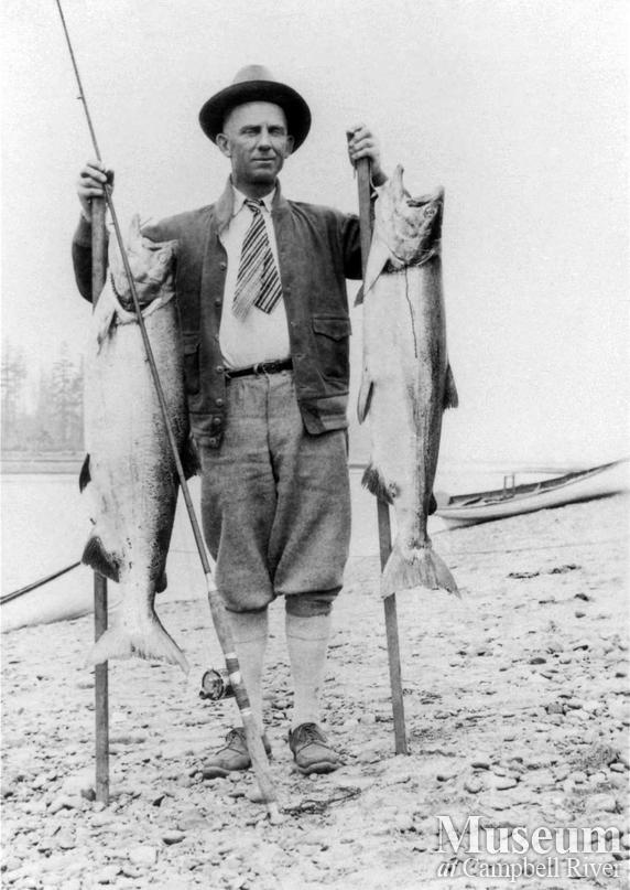 Unknown angler with two fish