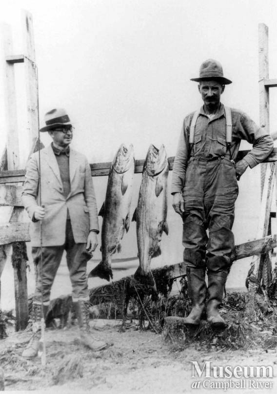 Ed Forrest, guide, with unknown angler and two fish
