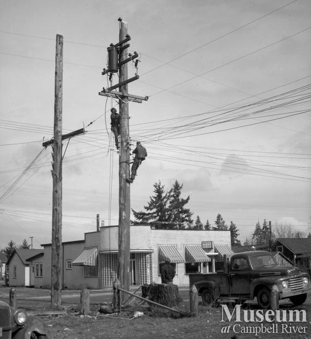BC Hydro employees working on pole in Campbellton