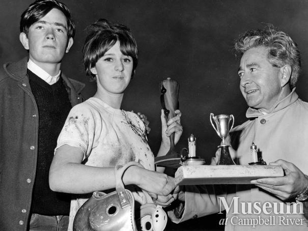 Campbell River high school Principal John Young presents trophy