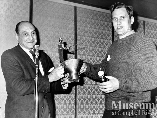 Roderick Haig-Brown presents George Raga with trophy