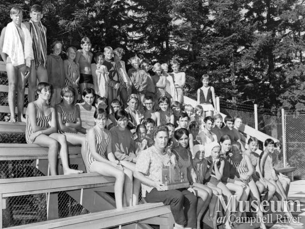 Members of the Campbell River Swim Club on bleachers at Centennial Park pool