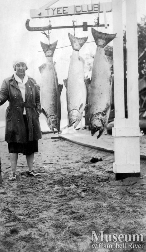 Unidentified woman with salmon at Tyee Club scale