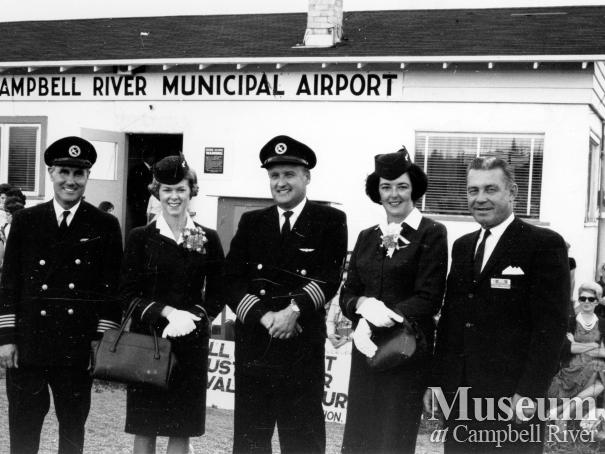 Flight crew in front of Campbell River Municipal Airport terminal