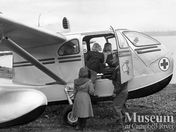 School children having a look at BC Airlines SeaBee