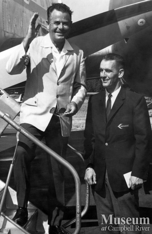 Actor Glenn Ford boards a Pacific Western Airlines plane