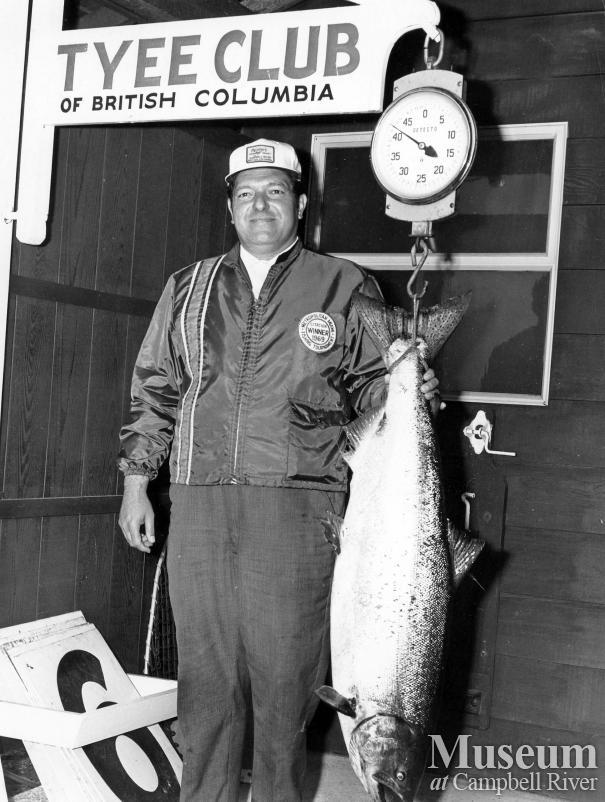 Raymond L. Knight with catch